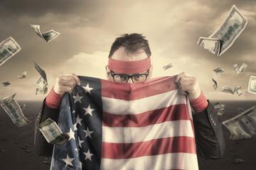 Businessman hiding behind USA flag