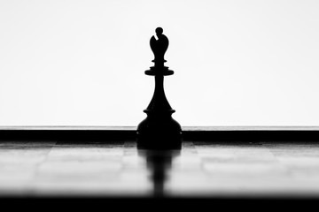 Bishop chess piece silhouette on a white background
