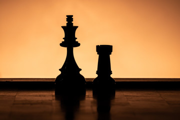 Silhouette King and Rooke Chess Pieces doing the Castling Game Move
