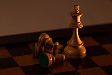 King Chess Piece lying on the side of Kingpiece in the chessboard