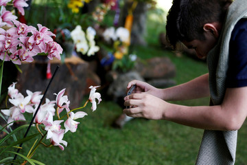 A man photographs orchids during the National Orchid Exhibition at the Jose Celestino Mutis Botanical Garden in Bogota
