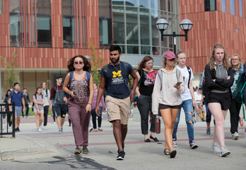 University of Michigan students walk on campus in Ann Arbor