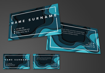 Business Card Layout with Blue Papercut Elements