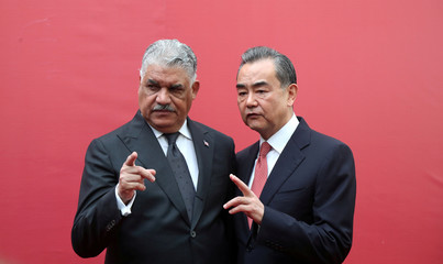 China's Foreign Minister Wang Yi and Dominican Republic's Chancellor Miguel Vargas gesture during the opening of the first Chinese Embassy in the Dominican Republic, in Santo Domingo
