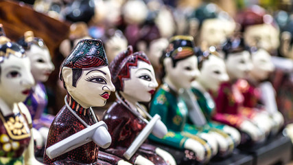 """wooden statue of Javanese groom and bride called """"Loro Blonyo"""" sold as souvenir for the tourist"""