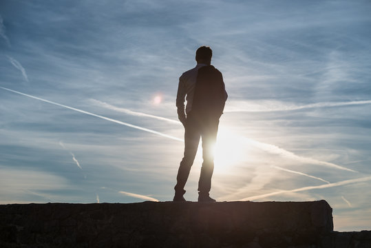 Man silhouetted against the setting sun