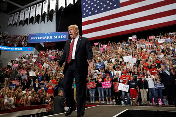 U.S. President Donald Trump takes the stage during a campaign rally in Springfield