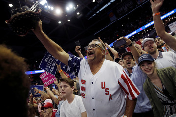 Supporters of U.S. President Donald Trump cheer as Trump arrives at a campaign rally in Springfield