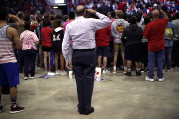 A supporter of U.S. President Donald Trump salutes during the playing of the U.S. national anthem at a campaign rally in Springfield