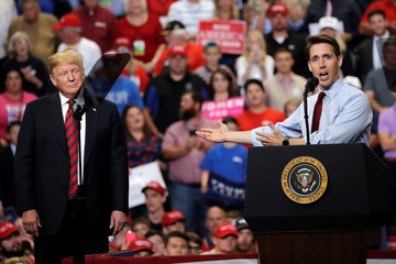 Missouri Attorney General and Republican U.S. Senate Candidate Josh Hawley appears on stage with U.S. President Donald Trump at a campaign rally in Springfield
