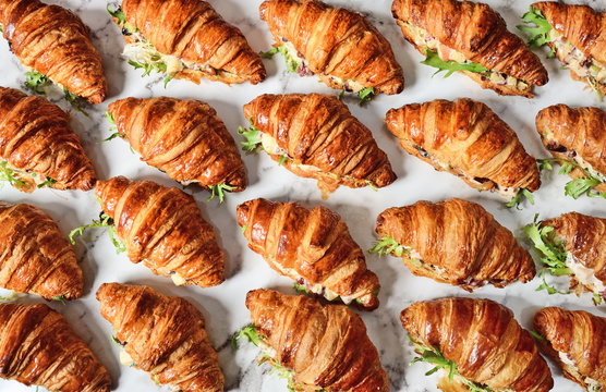 Chicken salad croissant sandwich on buffet table