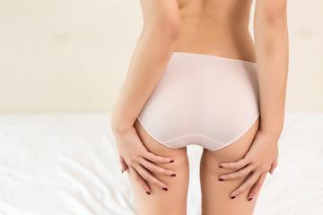 Girl buttocks on white background