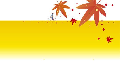 紅葉の道を走る自転車