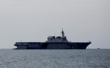 Japanese helicopter carrier Kaga anchored near a port in Jakarta ahead of its departure for naval drills in the Indian Ocean