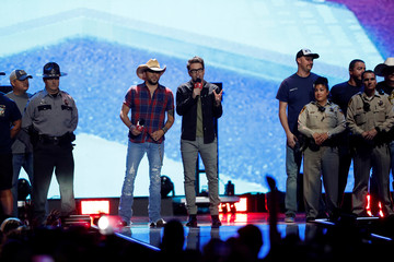 Jason Aldean and radio personality Bobbie Bones honor first responders of the Oct 1, 2017 Las Vegas mass shooting during the iHeartRadio Music Festival at T-Mobile Arena in Las Vegas