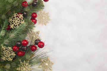 Christmas Background with Pine Tree Branches in the Snow