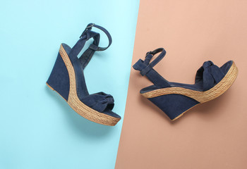 Female sandals on a platform on a colored paper background. on form. Fashionable summer shoes.