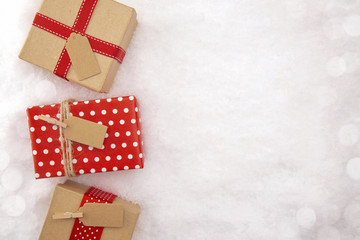 A Background of Elegantly Wrapped Gifts on a Bed of Snow