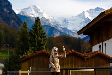 Beautiful girl photographer taking photos in Switzerland