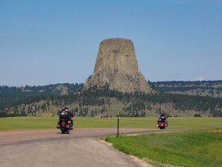 Bikers driving to Devils Tower National Monument at the Sturgis Motorcycle Rally in the Black Hills, Wyoming, USA
