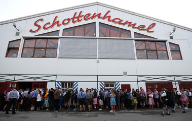 Visitors queue outside the tent at the opening day of the 185th Oktoberfest in Munich