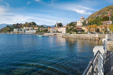 Aluminium Prints City on the water Beautiful small town on a large Italian lake. Lake Maggiore and the most characteristic area of Laveno with the lakeside promenade, the old harbor (on the right) and the new one (on the left)