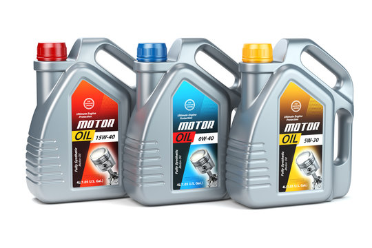 Plastic motor oil canisters with different types of motor oil on white isolated background.