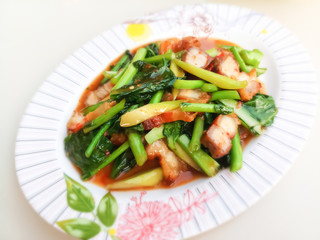 Stir fried kale with crispy pork / Thai Food is delicious