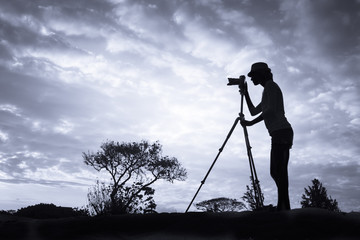 Landscape photography concept. Photographer taking pictures of sunset.