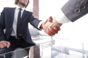 Close-up of two business people shaking hands