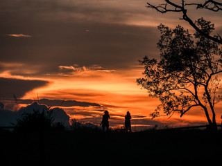 2 tourists took a photo and watched the sunset at the top of the mountain, on the day of mangkhut storm.Located about 1,633 meters above sea level, Phoosoidao, Uttaradit, Thailand.