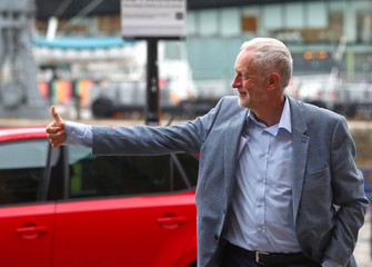 Britain's Labour Party Leader Jeremy Corbyn arrives at the Albert Dock, ahead of the Labour Party Conference, in Liverpool