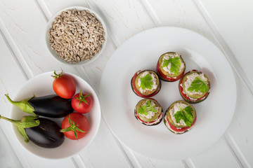 Appetizer from raw eggplants and tomatoes, sauce from sunflower seeds.