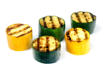green and yellow zucchini on a grill