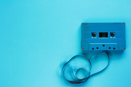 Retro cassette tape on blue background for audio recording and playback
