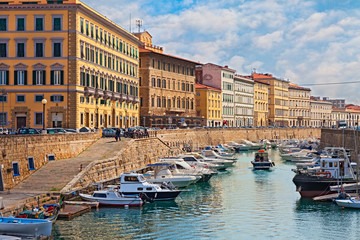 Leghorn, Tuscany, Italy: cityscape of the canal with boats