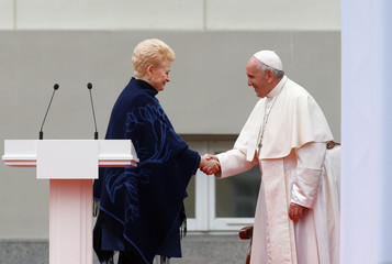 Pope Francis shakes hands with Lithuanian President Dalia Grybauskaite at the front of the Presidential palace in Vilnius