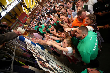 Visitors reach for the first mugs of beer during the opening day of the 185th Oktoberfest in Munich