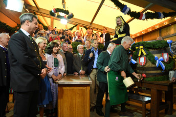 Munich mayor Dieter Reiter prepares to tap the first barrel of beer during the opening ceremony of the 185th Oktoberfest in Munich