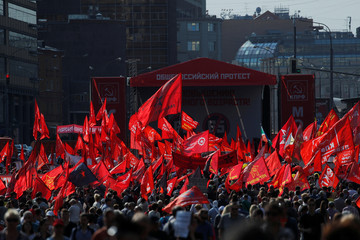 Supporters of left-wing political parties and movements take part in a rally against the pension reform in Moscow
