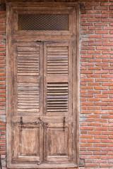 Old wooden door and brick wall