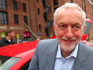 Britain's Labour Party Leader Jeremy Corbyn leaves the Albert Dock, ahead of the Labour Party Conference, in Liverpool