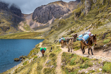 Inca Trail expedition passing a mountain lake in the high Andes of Peru