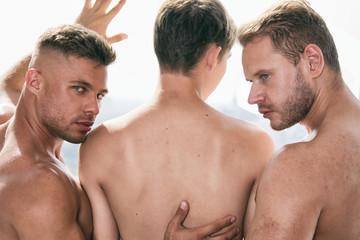 Three sexy guys. Gay family.