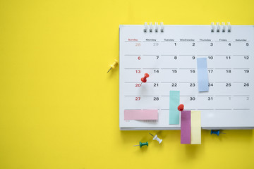 close up of calendar on the yellow background, planning for business meeting or travel planning concept Fototapete