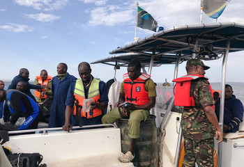 Tanzanian divers and rescuers search for bodies of passengers after a ferry MV Nyerere overturned off the shores of Ukara Island in Lake Victoria