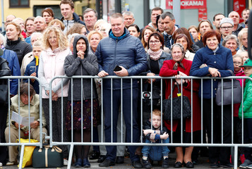 Faithful wait for the arrival of Pope Francis at the Gate of Dawn shrine in Vilnius