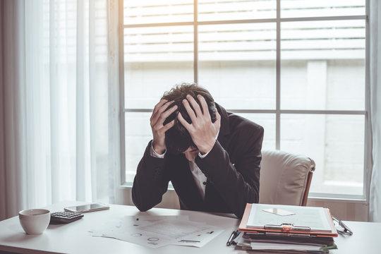 Business man unhappy in their work. Despair failed to work.