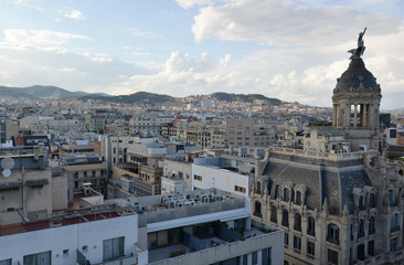 Rooftops and view of commercial and residential buildings in Barcelona Spain