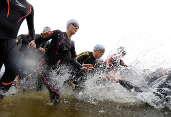 Competitors in the Swim Serpentine event enter the Serpentine Lake in Hyde Park, London
